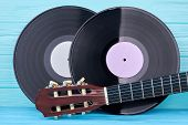 Vinyl Records And Guitar Head. Vinyl Lp Discs On Colored Background. Acoustic Guitar, Cropped Image. poster