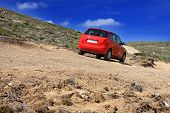 stock photo of rocky-mountains  - dirt road on a mountain slope - JPG