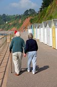 stock photo of senior prom  - Elderley couple out for an early morning stoll on the promenade - JPG