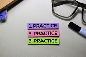 Practice. Practice. Practice Text On Sticky Notes Isolated On Office Desk poster