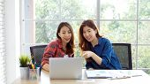 Asian Women At Home Office, Happy Two Young Asian Women Working With Laptop Computer At Office, Asia poster