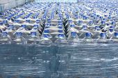 stock photo of bottle water  - Detail of stack bottled water in industry - JPG