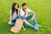 Fast Food. Bearded Man And Woman Enjoy Cheesy Pizza. Couple In Love Dating Outdoors With Pizza. Hung poster