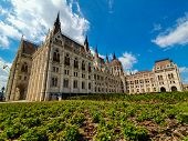 Panoramic View Of The Hungarian Parliament In Budapest On A Beautiful Summer Day With Clear Blue Sky poster