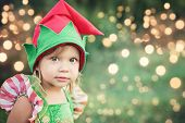 Child Waiting For A Christmas In Wood In Juli. Portrait Of Little Children Near Christmas Tree. Girl poster