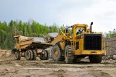 foto of oversize load  - Excavation and dump vehicle in a granite quarry - JPG