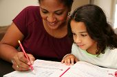 picture of student teacher  - Young girl at school working with teacher on handwriting - JPG