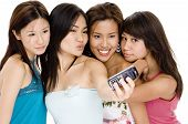 foto of foursome  - four pretty young asian women taking their photo with their phone - JPG