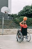 Disabled Man In Wheelchair Playing Basketball Alone, Concept Of Adaptive Sports And Physical Activit poster