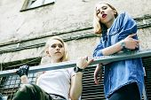 Couple Of Teenage Girls Ouyside On Streets Chilling, Lifestyle People Concept poster