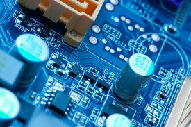 image of electrical engineering  - many electrical components on a computer mainboard - JPG