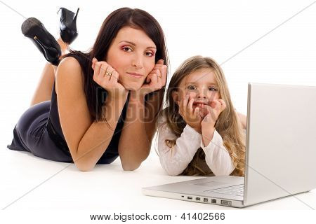 Mother Teaching Her Daughter How To Use Laptop