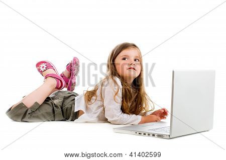 Little Girl Lying With Laptop