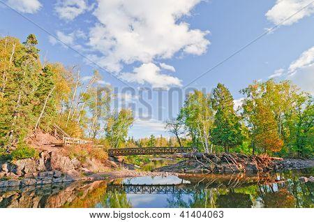 Scenic Bridge Over A Quiet Stream