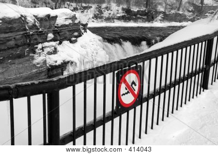 No Swimming Warning Sign On A Cold And Icy Ridge With Snow And Slippery Surfaces 3