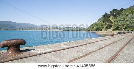 Rail Lines And Bollard On Disused Wharf.