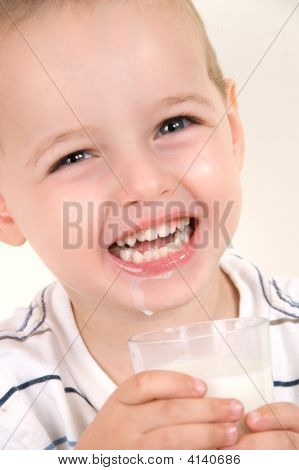Adorable Little Boy With Milk