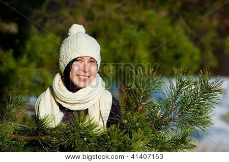 Beautiful young woman smiling in winter
