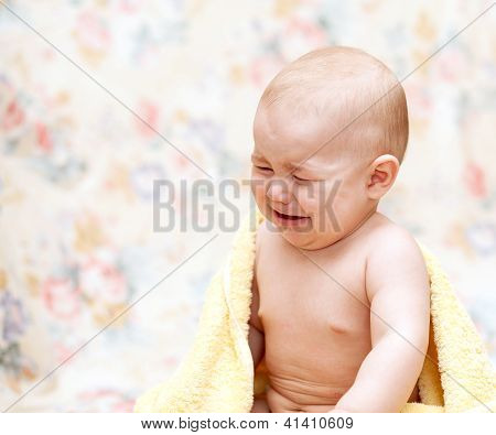 Baby Crying In A Yellow Towel