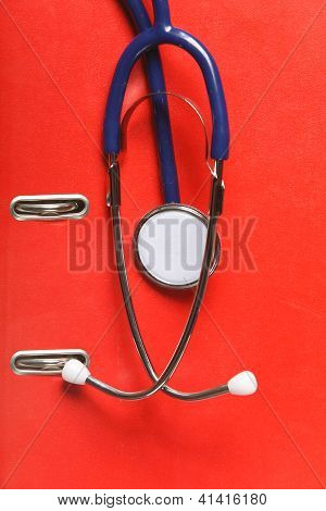 Blue Stethoscope On Red Background