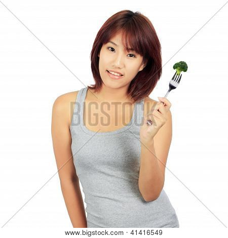 Isolated Young Asian Woman With A Picec Of Brocolli