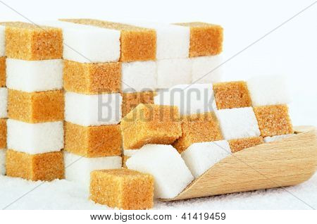Piles Of Brown And White Sugar Cubes