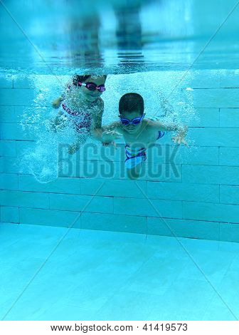 Girl and boy underwater
