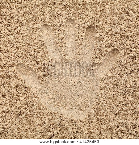 Hand In Sand On Beach