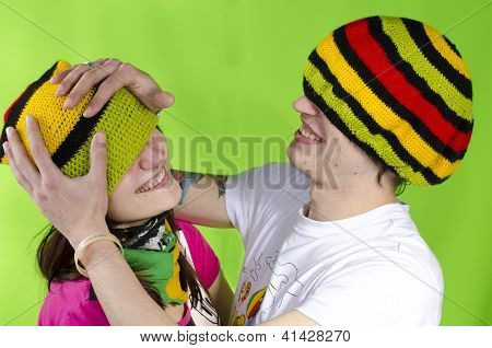 Loving couple in rasta-cap plays the fool
