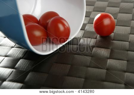 Group Of Cherry Tomatoes In Blue Bowl