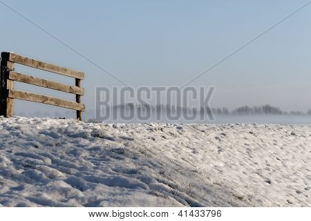Winter Landscape with wooden fence on the left