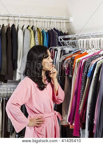 Mature Woman Deciding What Clothing To Wear