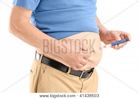 Mature man injecting insulin in his abdomen isolated on white background