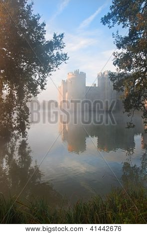 Stunning Moat And Castle In Autumn Fall Sunrise With Mist Over Moat