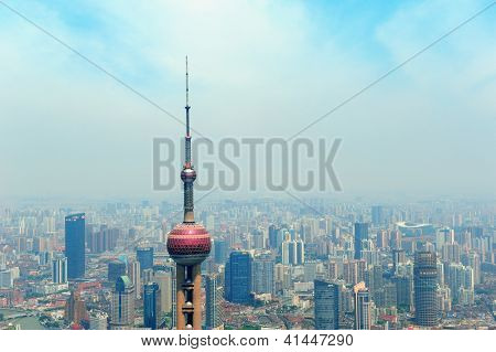 SHANGHAI, CHINA - MAY 28: Oriental Pearl Tower over river on May 28, 2012 in Shanghai, China. The tower was the tallest structure in China excluding Taiwan from 1994-2007 and the landmark of Shanghai.