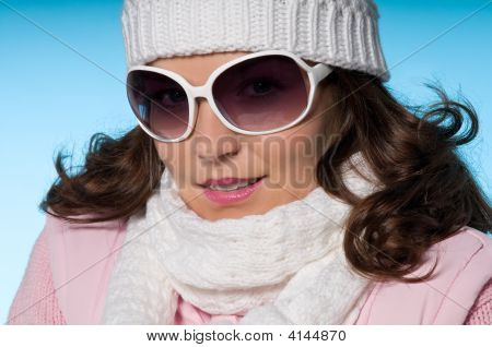 Close-Up Of Young Woman In Pink And White Winter Outfit