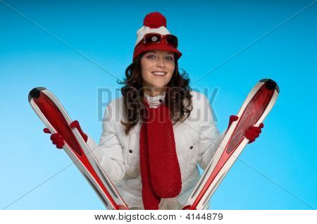 Smiling Young Woman In Red And White Skiing Outfit