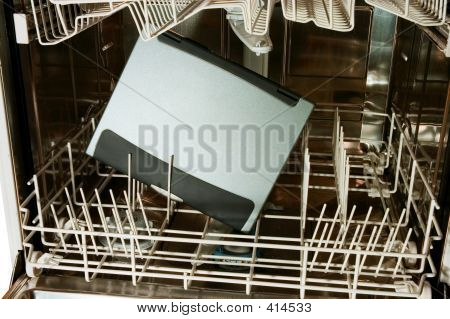 Notebook In Dishwasher Ready To Clean