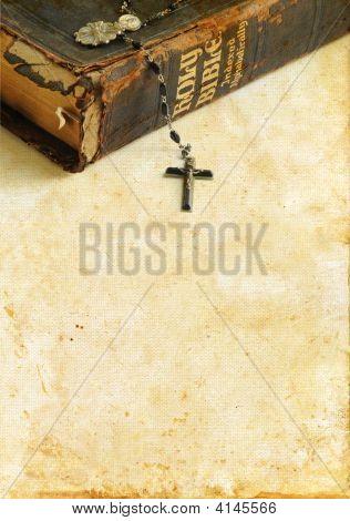 Antique Bible And Rosary On A Grunge Background