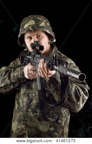 Alerted Soldier Keeping A Gun
