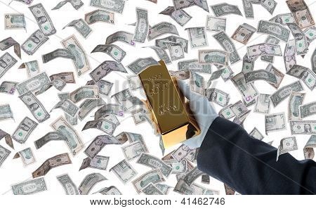 Bar Of Gold In Hand And Dollars