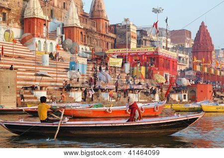 Hindu people making ritual bathing at ghats in holy Ganges River,Benares,India