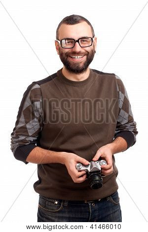 Young man with beard holding photo camera