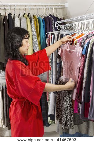 Mature Woman Coordinating Her Clothes