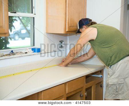 Carpenter Measures Counter Top
