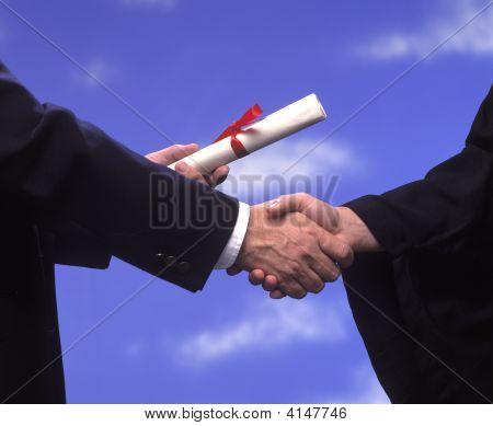 Diploma And Handshake