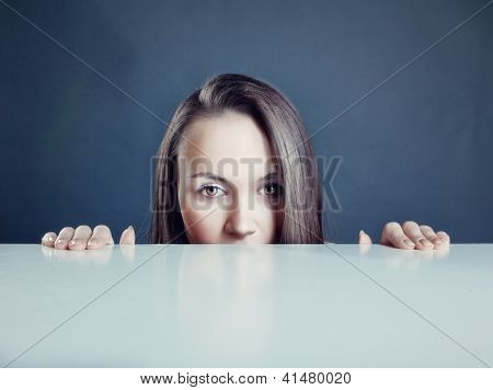 beautiful woman looking over a table