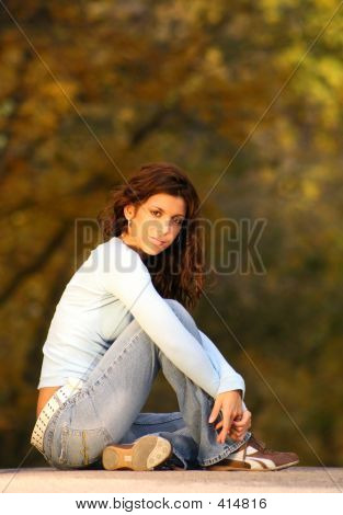 Brunette Sitting On The Road 2