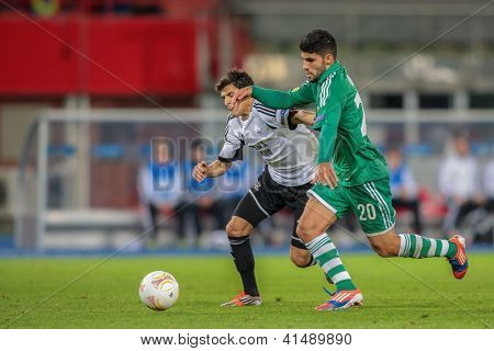 VIENNA,  AUSTRIA - SEPTEMBER 20 Muhammed Ildiz (#20 Rapid) and Tarik Elyounoussi (#17 Trondheim) fight for the ball during the Europa League soccer game on September 20, 2012 in Vienna, Austria.