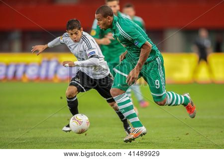 VIENNA,  AUSTRIA - SEPTEMBER 20 Terence Boyd (#9 Rapid) and Christian Gamboa (#2 Trondheim) fight for the ball during the Europa League soccer game on September 20, 2012 in Vienna, Austria.